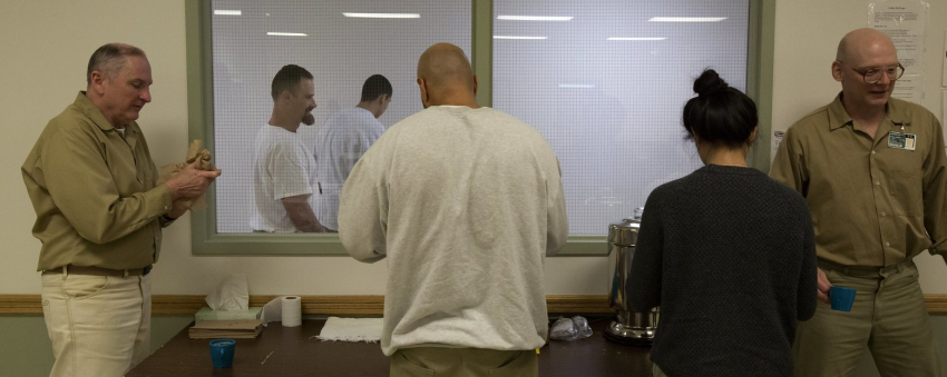 Inmates and students take a break from classwork. (Sy Bean/The Seattle Times)