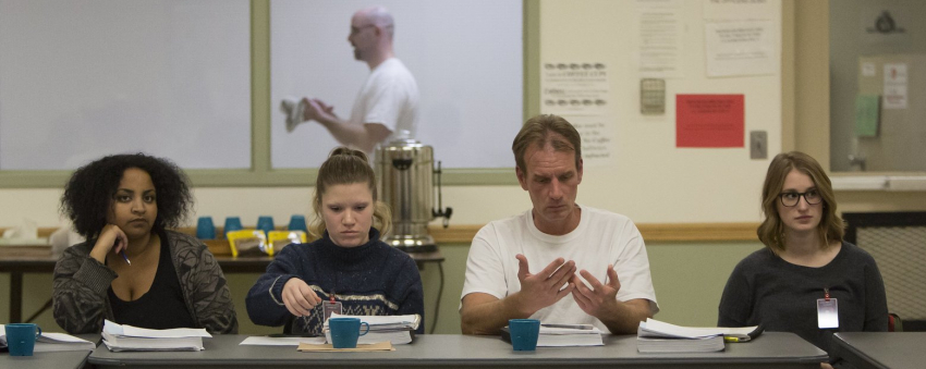 From left, UW students Meron Fikru, Emily Krueger, inmate Art Longworth and UW student Kathryn Joy give a presentation on prison reform. (Sy Bean/The Seattle Times)