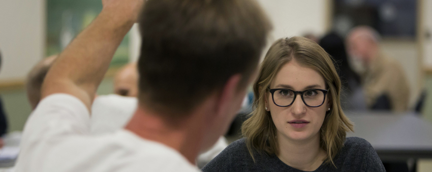 Kathryn Joy, a Law, Societies and Justice and French major, talks with inmate Art Longworth, who was convicted of aggravated murder and is serving life without parole, as they work during a UW mixed-enrollment class at... (Sy Bean/The Seattle Times)