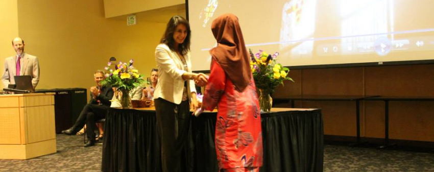 Graduate Nur Abd Rahim Receiving their Degree from Dr. Arzoo Osanloo