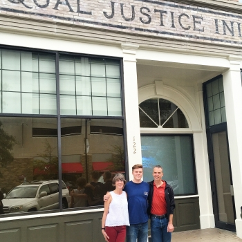 Bryce Ellis stands in front of the Equal Justice Initiative in Montgomery, Alabama with his parents