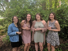 LSJ Graduates pose with their LSJ Pint Glasses