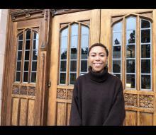 Sasha outside Smith Hall doors