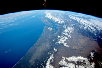 arial photo of the earth on a sunny day, focused in on the pacific northwest, mainly Washington state