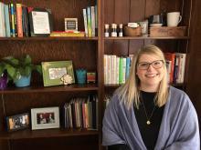 Kat Eli sitting down in her LSJ Office