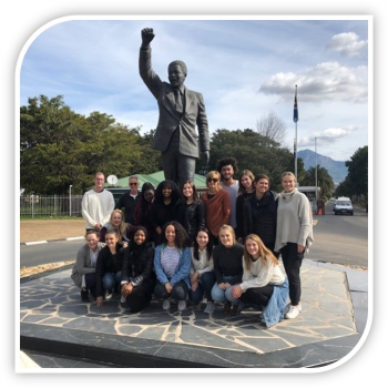Group of students from South Africa Study Abroad program by a statue